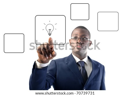 African businessman pressing a button of a touchscreen with a light bulb on it - stock photo