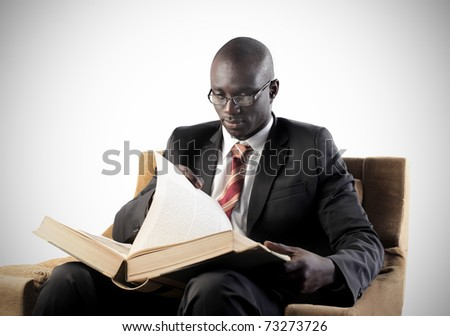 African businessman reading a book