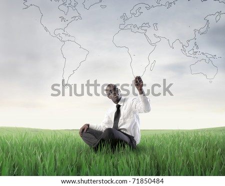 african businessman sitting on...