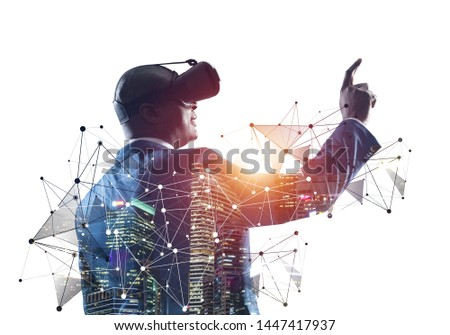 African businessman wearing VR headset working with virtual system. New reality modeling and design. Virtual interface using. Mixed media with 3d objects. Business model simulation technology