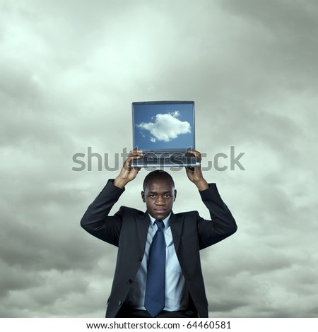 African businessman with a cloud computing solution over a technology storm (cloud computing concept)