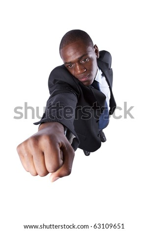 African businessman with his fist up (isolated on white)