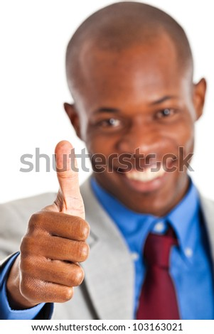 African businessman with thumbs up