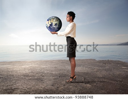 African businesswoman holding the Earth in his hands