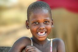African child portrait in a dress, in a village in Botswana