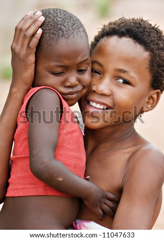 African children brother and sister, social issues, poverty, village near Kalahari desert