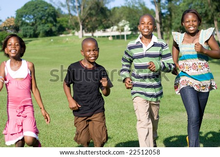 african children running in the park towards camera