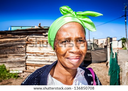 african colored woman wearing a lime green head wrap