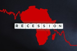 African continent with the red financial chart on black background. Africa in economic recession and crisis due to coronavirus or covid-19 outbreak.