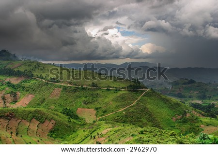 African countryside landscape with rainy clouds - stock photo