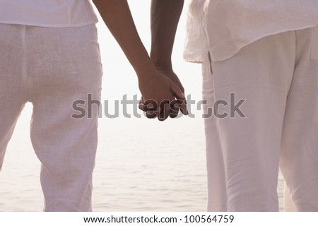 African couple holding hands outdoors