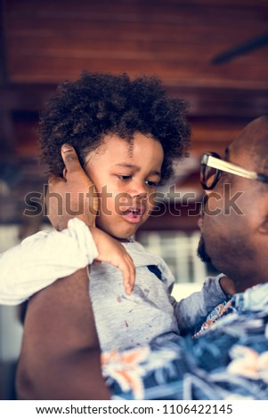 African dad soothing a crying child