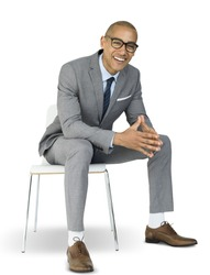 African Descent Business Man Sitting Smiling