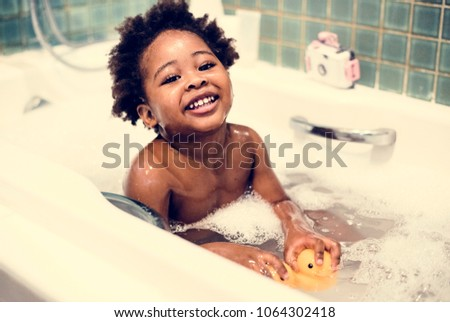 african descent kid enjoying...