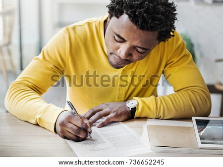 African descent man is filling an application