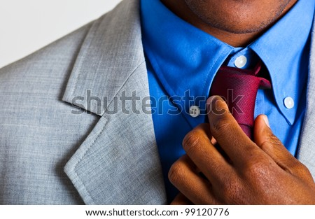 African elegant man adjusting his collar