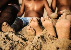 African family enjoying the beach