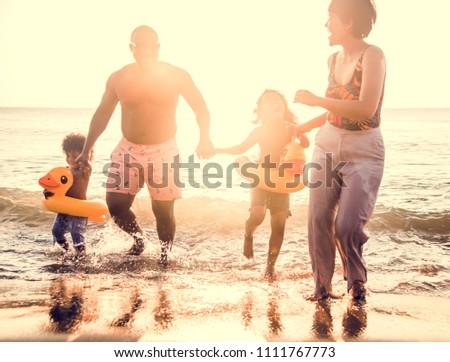African family enjoying the beach #1111767773