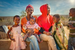 African family group of kids and teenagers,  village in Botswana