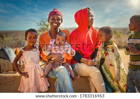African family group of kids and teenagers,  village in Botswana Сток-фото ©