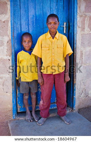 african family, two brothers, living  in a very poor village near Kalahari desert - stock photo