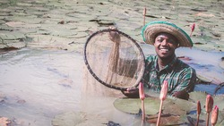 African farmer carry nets used to catch fish on his farms.Agriculture or cultivation concept