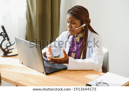 African female doctor consulting patient make online webcam video call on laptop. Black woman therapist videoconferencing in remote computer healthcare telemedicine virtual chat. Telehealth videocall.