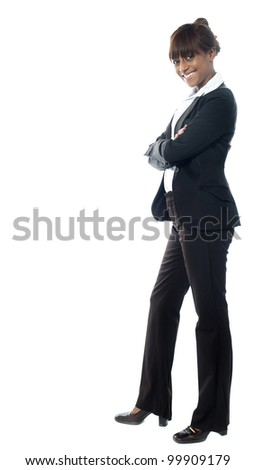 African female manage looking st you. posing against white