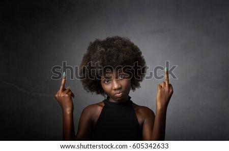 african girl double rude gesture, dark background #605342633