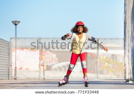 African girl exercising at outdoor rollerdrom #771933448