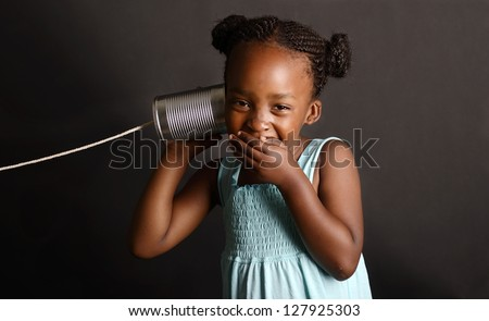 African girl with a tin and string on her ear