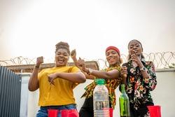 african girls dancing at an outdoor party, having fun