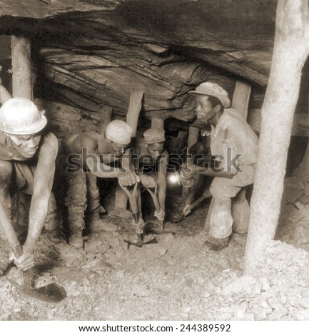 African gold miners developing a drift, a tunnel following a vein of ore, in the Crown Mine, in the greatest gold bearing region of the world, near Johannesburg, South Africa. 1935.