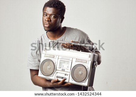 African guy guy tape recorder boombox music fun