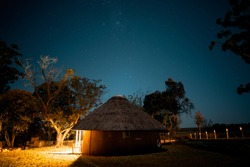 African hut in the night, astronomy photography