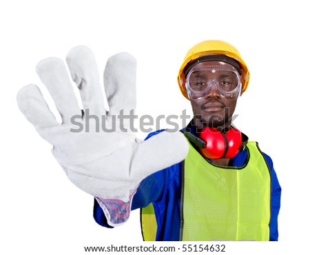 african industrial worker or builder giving stop sign