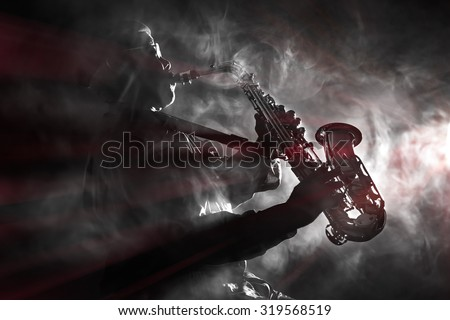African jazz musician playing the saxophone. Black and white with color flare