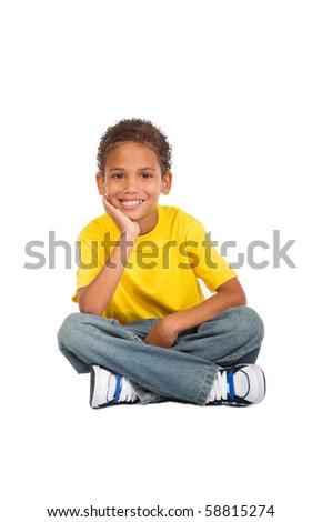 african kid boy sitting on floor
