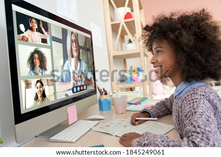 African kid child girl distance learning during virtual distance online class on video conference call with teacher, tutor and school children group studying at home. Elearning zoom class on computer.