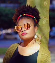 African Lady with Zulu Hairband on Her Afro Wearing Sunglasses