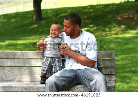 African Latin Toddler with African American Man