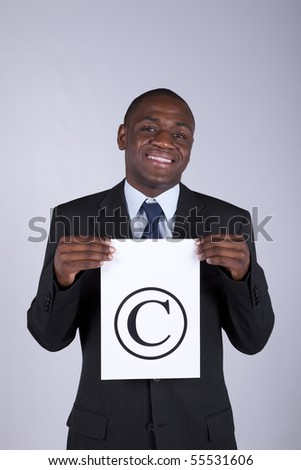 african lawyer businessman holding a copyright symbol