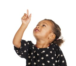 African little girl pointing her finger up, isolated on white