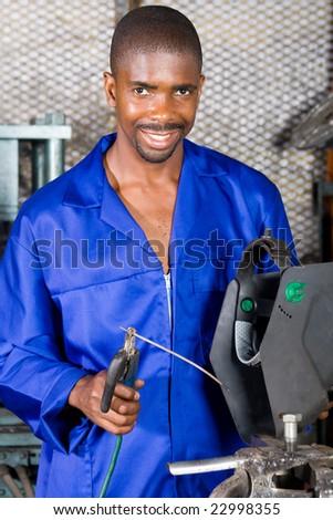 african male welder portrait with welding equipment