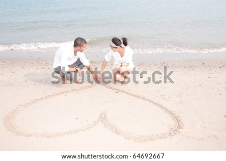 african man and asian woman lover on the beach