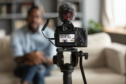 African man blogger sit on sofa record new vlog view through digital camera screen close up. Vlogger share new information with subscribers using modern digital equipment webinar videovlogging concept