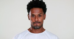 African man feeling surprised, expressive portrait showing angst emotion