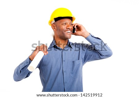 African man in hard hat talking on his mobile phone holding building plans isolated on white