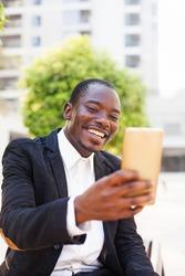 african man using video call app