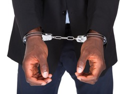 African Man With Handcuffed Hands Isolated On White Background